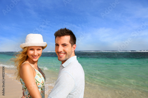 Portrait of cheerful couple at the beach