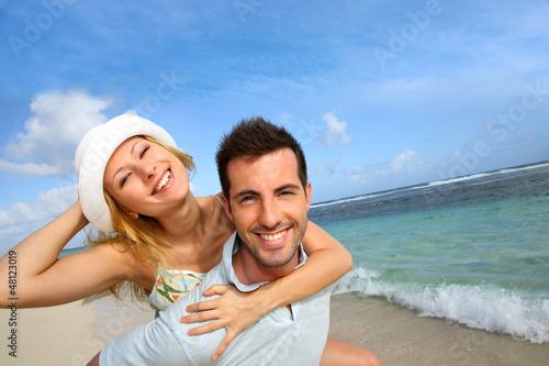 Cheerful couple enjoying vacation at the beach