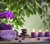 Fototapety Spa still life with zen stones aromatic candles and orchids