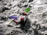 Kayaker in white water, rafting