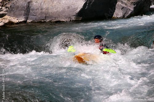 Kayaker in white water - 48125284