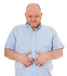Mann mittleren Alters klagt über Bauchschmerzen