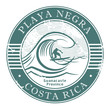 Stamp with surfer on wave and name of Playa Negra, Costa Rica