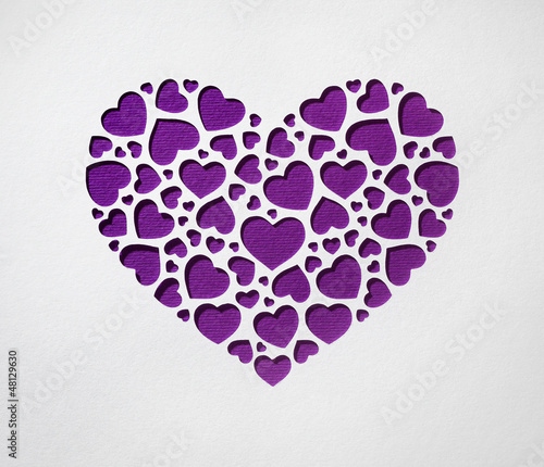 Valentine day heart made of small hearts on paper card