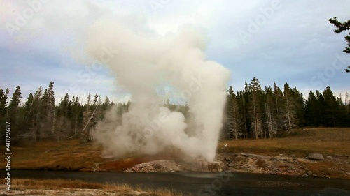 eruption of Riverside Geyser,Yellowstone NP