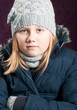 Cold child in winter clothing