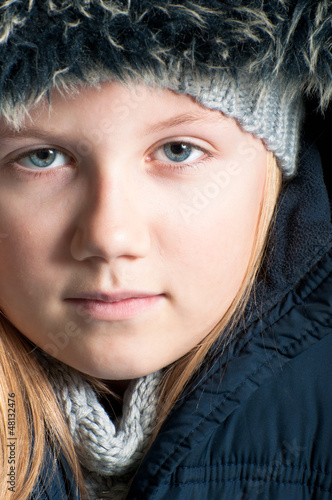 Winter child wearing a fur hat