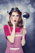 Redhead housewife with soup ladle