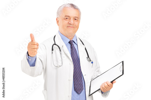 A male doctor standing and giving a thumb up