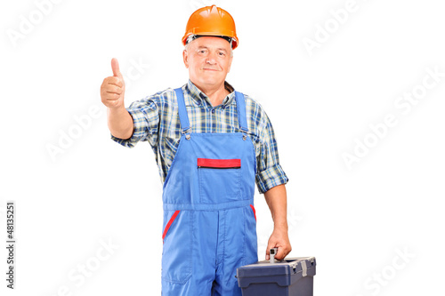 A manual worker holding tool box and giving a thumb up