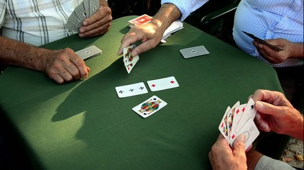Seniors playing Scopa,  Italian card game