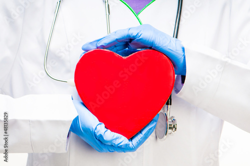 doctor holding red heart