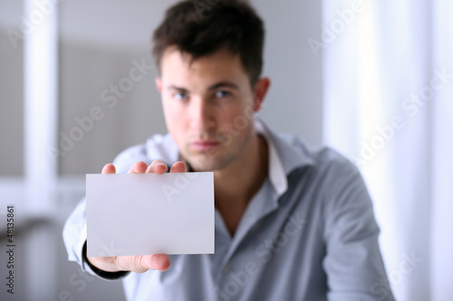 man who shows a business card