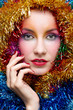Woman in tinsel Christmas costume