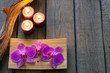 Orchids and candle spa cosmetic background abstract