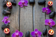 Orchids and spa stones border background on wooden boards