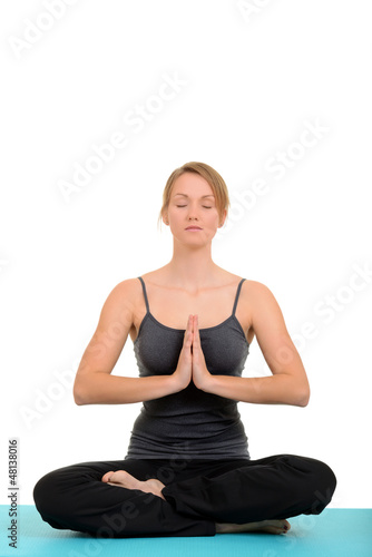 Young blond woman doing yoga