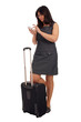 Business woman with suitcase and mobile phone