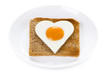 heart shaped cooked egg on toast