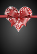 heart with bow on dark background