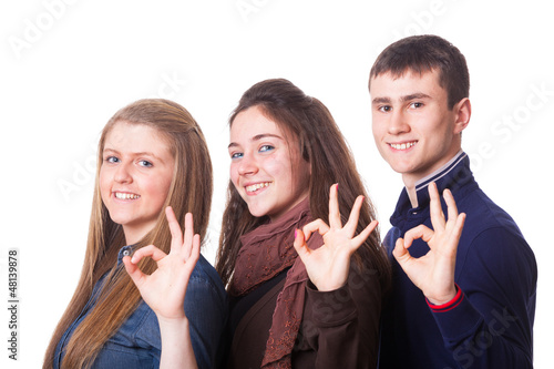 Teenage Students Making Ok Sign