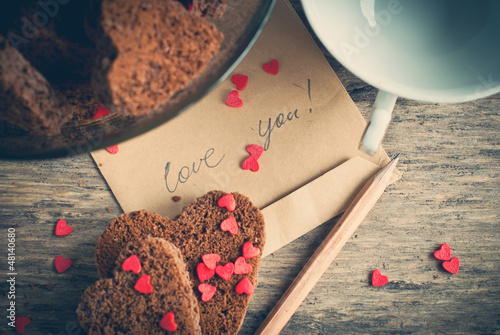 Card with Message Love You and Chocolate Cookies in the Shape of
