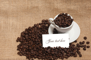 Cup of coffee beans with white card for text