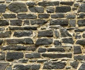 seamless black ashlar old stone wall texture