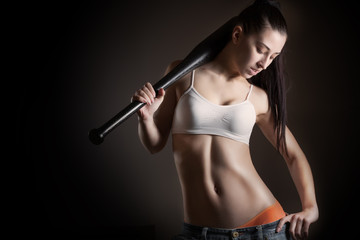 beautiful brunette woman with baseball bat