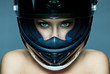 Sexy woman in helmet on blue background