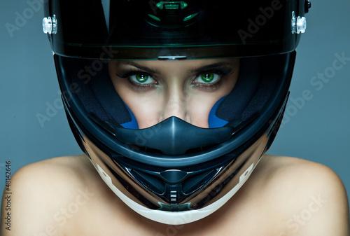 Fototapeta Sexy woman in helmet on blue background