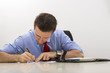 Busy businessman filling paper documents
