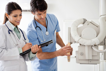 Radiologist And Technician Working Together