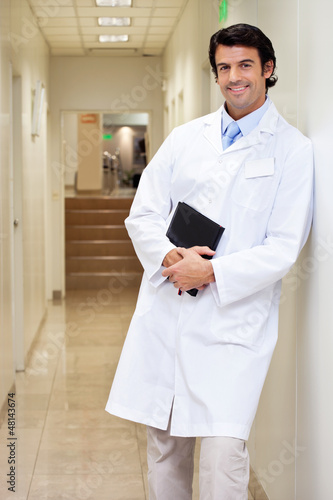 Happy Male Doctor Holding Book
