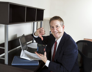 Mature Man giving Thumbs Down on Income Tax Results