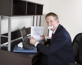 Mature Man Biting Income Tax Papers