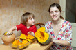mother with child cooks pumpkin