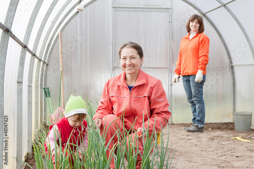 family works in greenhouse