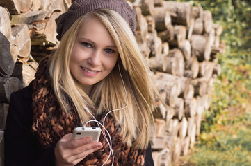 Smiling Pretty Girl with Smartphone