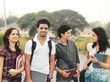 Group of Indian / Asian college students in the campus ground.