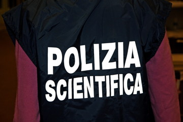 italian scientific policeman with the jacket with reflective wri