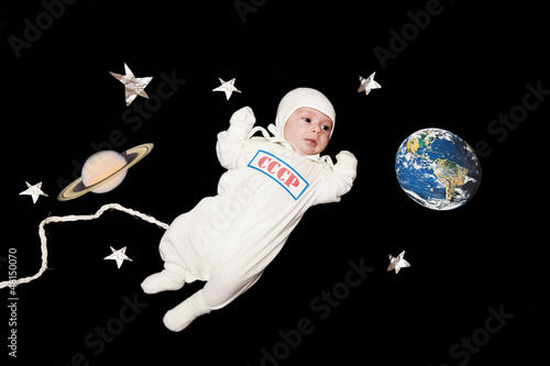 """""""baby astronaut in space on a black background"""" Stock ..."""