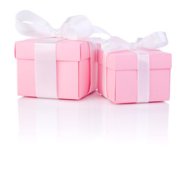 Two Pink gift box tied white satin ribbon bow Isolated on white