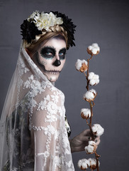 Beautiful woman in skull makeup