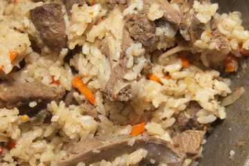 background of rice with meat. pilaf