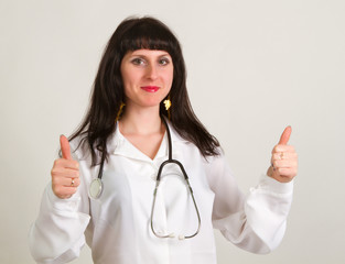 female doctor with thumbs up gesture