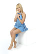 Wet blonde girl wiped blue towel