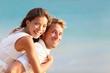 Multiracial people: Happy couple piggyback