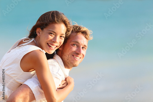 Multiracial people: Happy couple piggyback