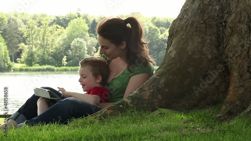 mum and son with tablet in a park